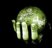 Globe in a girl's hands Royalty Free Stock Image