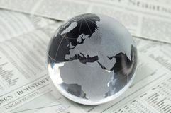 Globe of glass on business statistics stock photography