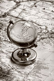 Globe glass on old map Royalty Free Stock Image