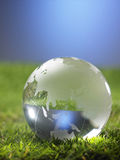 Globe. Glass globe resting on the grass Stock Images
