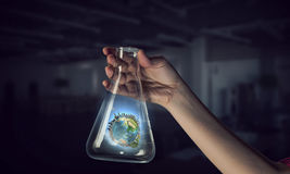 Globe in glass tube . Mixed media Stock Images