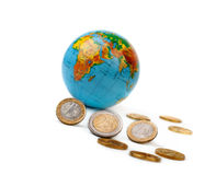 Globe and golden coins. Royalty Free Stock Photo