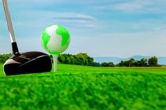 Globe on golf ball on green grass. Idea and green earth concept royalty free illustration