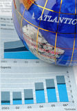Globe and graph of economy. A globe and graph increase and information of economy, means world wide economy, development and business concept Stock Photos