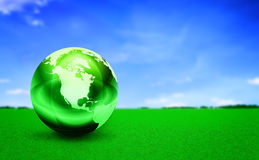 Globe on grass Royalty Free Stock Images