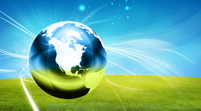Globe on grass Stock Images