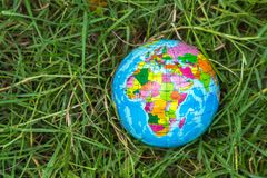 Globe on the grass, environment concept. Stock Photo