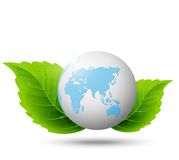 Globe and green leaf Royalty Free Stock Photos