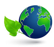 Globe and green leaves Stock Photo