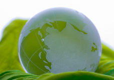 Globe on green satin Stock Photo
