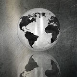 Globe on a grunge brushed metal background Royalty Free Stock Image