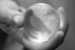 Globe in a hand. Royalty Free Stock Photography