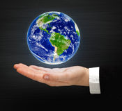 Globe on the hand Royalty Free Stock Photos