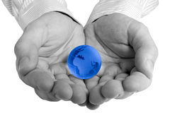 Globe in hand. Conceptual image of a globe in hand stock image