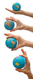 A globe on hand. Set of a globe on hand isolated Stock Photos