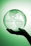 Globe in hand royalty free stock photography