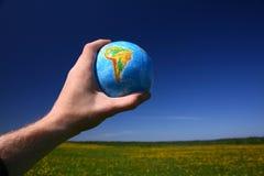Globe in hand Royalty Free Stock Photo