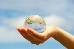 Globe in hand Royalty Free Stock Photos