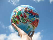 Globe in hand Stock Images