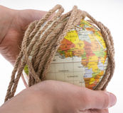 Globe in hand wrapped with rope Stock Photography