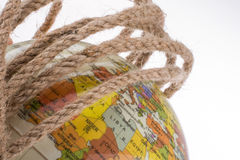 Globe in hand wrapped with rope Royalty Free Stock Image