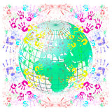Globe with handprints. Globe with colored prints of hands Royalty Free Stock Images