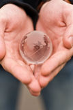 Globe in hands Stock Photography