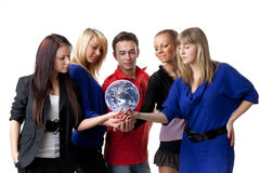 The globe in hands. The group of young people holding the globe in hands on a white background.  Concept for environment conservation Royalty Free Stock Images