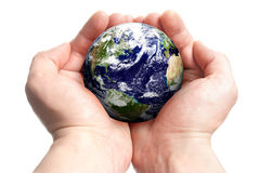 Globe in hands. Isolated globe in man's hands Royalty Free Stock Photo