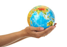Globe in the hands. Globe in the women's hands Royalty Free Stock Images
