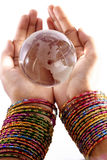 Globe in the hands Stock Photography
