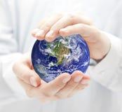 Globe in hands Stock Image