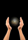 Globe and hands Stock Photography