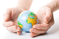 The globe in hands Stock Photography