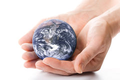 The globe in hands Stock Images