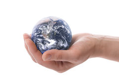 The globe in hands Royalty Free Stock Photography
