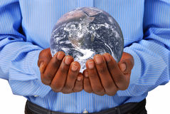 The globe in hands. Earth picture courtesy of Nasa stock photo