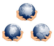 Globe in Hands. Blue Stock Photo