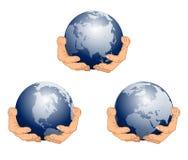 Globe in Hands. Blue stock photo