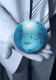 Globe in hands at the businessman Stock Photos