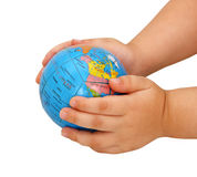 The globe in hands of the child Stock Images