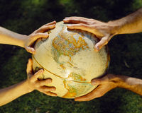 Globe in hands, environmental care Royalty Free Stock Photo