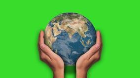 Globe between the hands. Green screen stock video