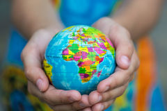 Globe in hands Royalty Free Stock Photos