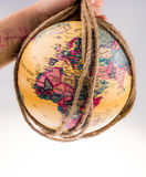 Globe hanging in rope Royalty Free Stock Images