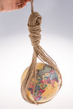 Globe hanging in rope Stock Images