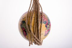 Globe hanging in rope Royalty Free Stock Image