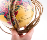 Globe hanging in rope Stock Photo