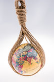 Globe hanging in rope Stock Photos