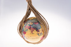 Globe hanging in rope Royalty Free Stock Photography